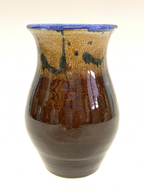 brown vase with blue top